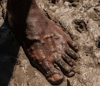 Aboriginal bare foot in mud
